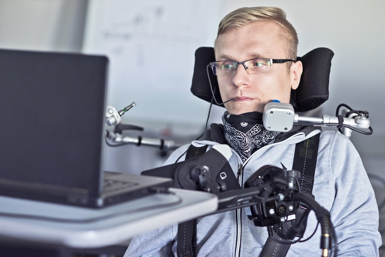 disabled man using assistive technology with computer